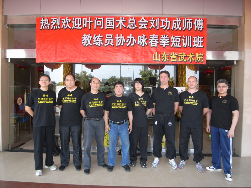 Group photo of Mr Lau and coaches at Shandong Province, China
